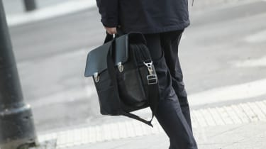 A man carrying a briefcase