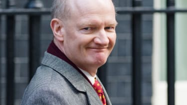 Minister of State for Universities and Science David Willetts leaves number 10, Downing Street following a cabinet meeting in London on December 4, 2012. AFP PHOTO/Leon Neal(Photo credit shou