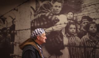 Holocaust survivor at an exhibition in the former Auschwitz concentration camp