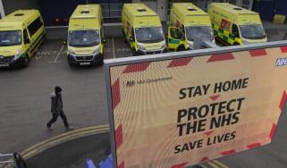 A man passes ambulances lined up outside the Royal Liverpool University Hospital.