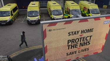 A man passes ambulances lined up outside the Royal Liverpool University Hospital.