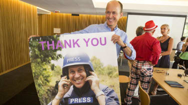 Peter Greste's brother, Andrew, holding a picture of Peter