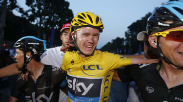 Tour de France 2013 winner Britain's Christopher Froome (C) celebrates with teammates on the Champs-Elysee avenue in Paris, after finishing the 133.5 km twenty-first and last stage of the 100