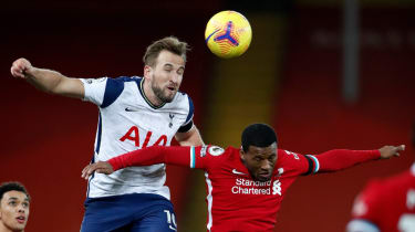 Tottenham's Harry Kane and Liverpool's Georginio Wijnaldum battle for a header