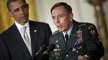 WASHINGTON - APRIL 28: President Barack Obama (L) listens while his nominee for Director of the Central Intelligence Agency (CIA), Army Gen. David Petraeus, speaks in the East Room of the Whi