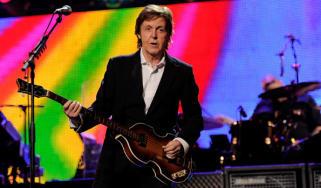 Sir Paul McCartney performing onstage