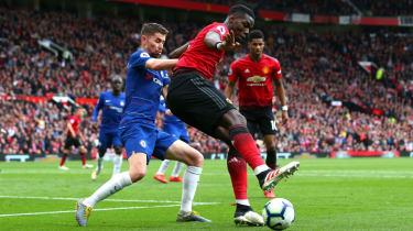 Manchester United midfielder Paul Pogba in action against Chelsea's Jorginho