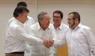 President Santos shakes hands with Farc leader Timonchenko