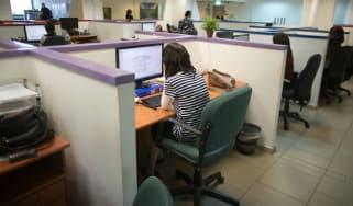 wd-worker_desk_-_menahem_kahanaafpgetty_images.jpg