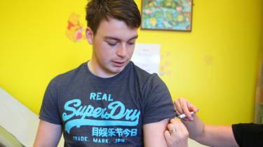 Teenage boy being vaccinated