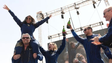 Richard Branson cheers with crew members after flying into space
