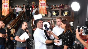 Simon Cowell being interviewed