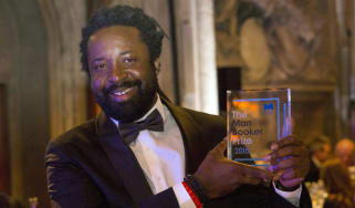 "LONDON, ENGLAND - OCTOBER 13:Author Marlon James winning author of ""A Brief History of Seven Killings"", poses with his awardat the ceremony for the Man Booker Prize for Fiction 2015 at The Gu"