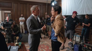 Daniel Craig talks to director Cary Joji Fukunaga on the set of James Bond: No Time to Die at Pinewood Studios (007.com)