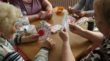 Elderly people playing bridge