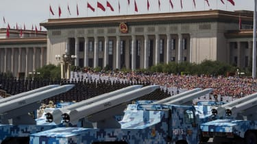 Chinese missiles seen on trucks as they drive next to Tiananmen Square