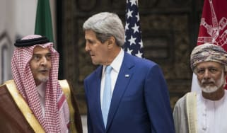 US Secretary of State John Kerry, Saudi Foreign Minister Prince Saud al-Faisal and Omani Foreign Minister Yussef bin Alawi