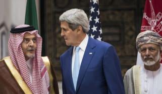 US Secretary of State John Kerry, Saudi Foreign Minister Prince Saud al-Faisal and Omani Foreign Minister Yussef bin Alawi