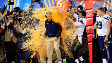 EAST RUTHERFORD, NJ - FEBRUARY 02:Tight end Zach Miller #86 and quarterback Russell Wilson #3 of the Seattle Seahawks dump Gatorade on head coach Pete Carroll in the fourth quarter of Super B