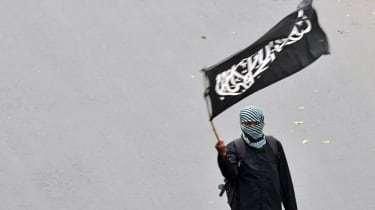 A Muslim supporter of the Indonesian section of the pan-Islamic organisation Hizbut Tahrir