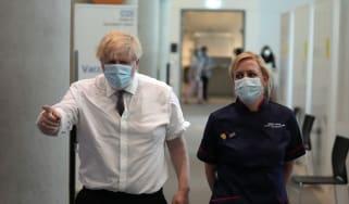 Boris Johnson arrives to receive his second dose of the Oxford-AstraZeneca vaccine