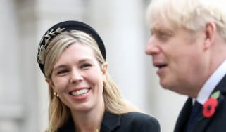 Boris Johnson and his partner Carrie Symonds attend a Remembrance Sunday ceremony at the Cenotaph on Whitehall