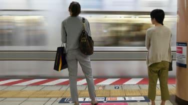 Women wait for a train in Japan
