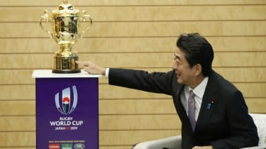 Japan's Prime Minister Shinzo Abe is pictured with the Webb Ellis Cup