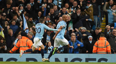 Manchester City fans celebrate Vincent Kompany's winning goal against Leicester