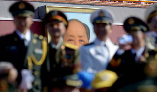 Mao Zedong looms large over a military parade in Tienanmen Square