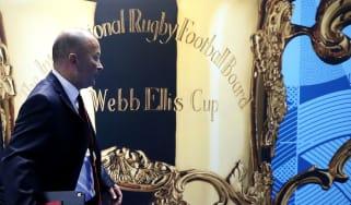 England head coach Eddie Jones walks past a picture of the Webb Ellis Cup