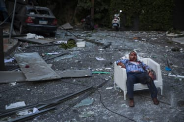 BEIRUT, LEBANON - AUGUST 04: (EDITORS NOTE: Image contains graphic content.) An injured man rests in a chair after a large explosion on August 4, 2020 in Beirut, Lebanon. Video shared on soci