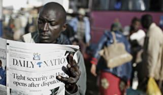 Kenyan reading newspaper