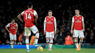 Arsenal players react after Brighton's winner at the Emirates Stadium