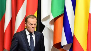 European Council President Donald Tusk in front EU national flags