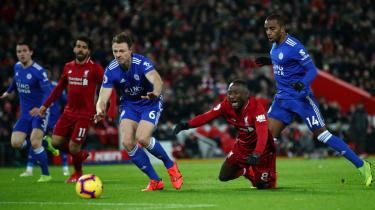 Liverpool's Naby Keita is challenged by Leicester City's Ricardo Pereira but no penalty was given