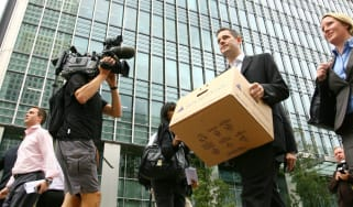 Lehman Brothers employees leave the bank's EU HQ in London in 2008