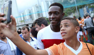 Danny Welbeck takes a selfie with a Brazilian fan at the World Cup
