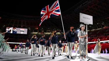 Flag bearers Hannah Mills and Mohamed Sbihi of Team GB