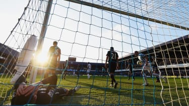 LONDON, ENGLAND - MARCH 22: James McCarthy of Everton lies in the goal after the goal scored by Eduardo Vargas of QPR (not in picture) during the Barclays Premier League match between Queens