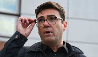 Andy Burnham speaks to the media at a press conference outside The Bridgewater Hall in Manchester.