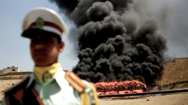 Iranian authorities burn confiscated drug shipments