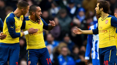 Theo Walcott with his Arsenal teammates celebrate after scoring a goal against Brighton