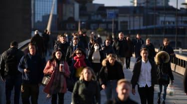 Commuters cross London Bridge this morning.