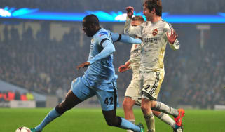 Manchester City's Yaya Toure vies with CSKA Moscow's Mario Fernandes