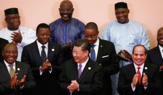 Xi Jinping surrounded by African leaders
