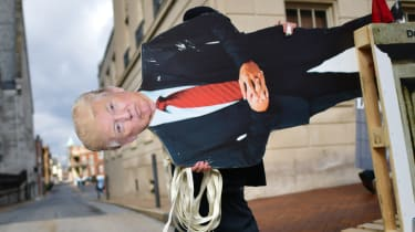 An effigy of Donald Trump is wheeled towards the Capitol ahead of the inauguration