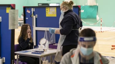 A pupil uses a lateral flow test on her return to school today