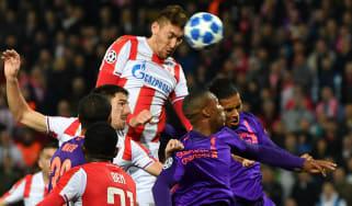 Milan Pavkov heads in Red Star Belgrade's opening goal against Liverpool