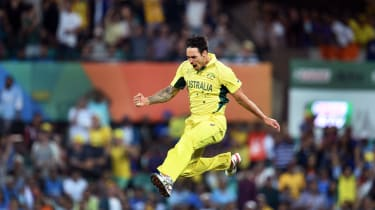 Australian paceman Mitchell Johnson celebrates after bowling India's batsman Rohit Sharma during their 2015 Cricket World Cup semi-final match in Sydney on March 26, 2015.AFP PHOTO / William